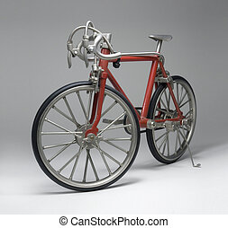 model of a red framed bicycle in light grey back, with...