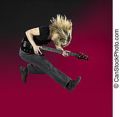 jumping bass guitar woman - a jumping woman with black bass...
