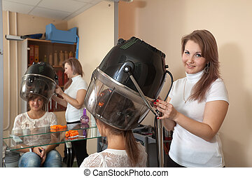 hairdresser working with hair dryer - Female hairdresser...