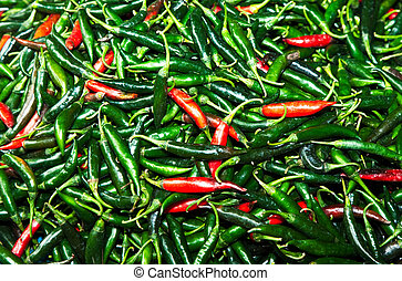 fresh chili pepper in different colors at the herb market in...