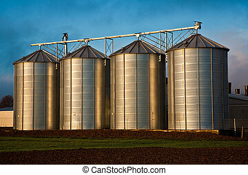 Silo in beautiful landscape with dramatic light