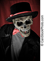 Skeleton in suite portrait on red background