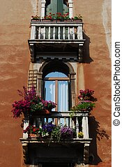 Windows with balcony and flowers