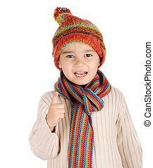 Cute kid with winter clothes isolated in studio