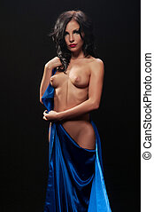beautiful nude woman with dark hair in blue cloth