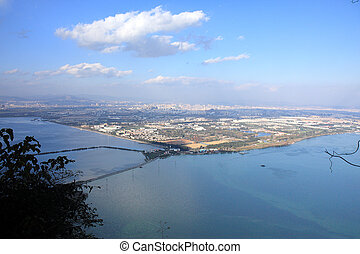 Kunming City - Aerial view of the city from the peak of...