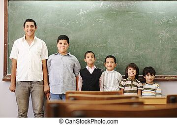 Children in school, from kindergarten, preschool, elementary...