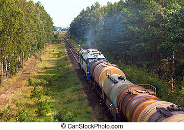 Freight diesel train - Freight train passing the countryside...