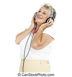 senior woman listen music - portrait of pretty senior woman...