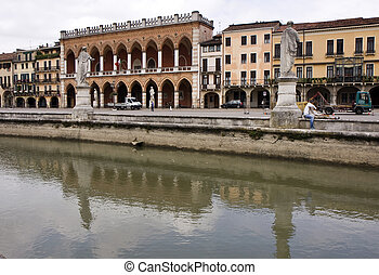 Padua - Statues and buildings in a park in center of Padua,...