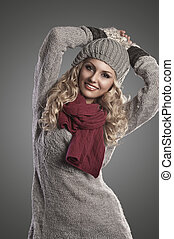 winter fashion girl in grey wool - beautiful blonde curly...