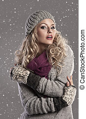 fashion blonde winter girl - attractive young woman in a...