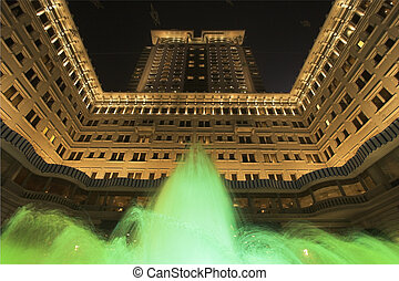 Grandiose show - The jets of a fountain illuminated by green...