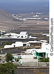view to typical old houses in Yaiza in volcanic area, Lanzarote