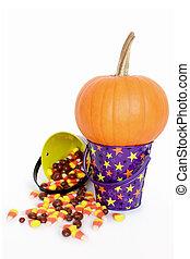 Halloween pumpkin and candy