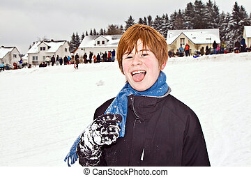 boy with red hair enjoying the snow - boy with red hair...