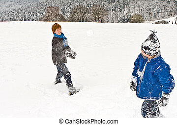 children in a snowball fight