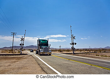 railway crossing on Route 95 near village Vidal with truck