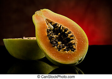 Papaya on shiny glass table - photo of delicious cutted...