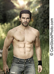 Man outdoors - Portrait of a hunky male fitness model...