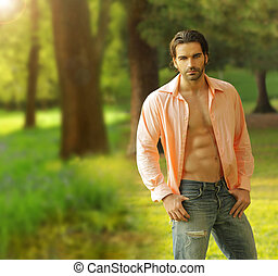 Male model outdoors - Beautiful male model with open shirt...