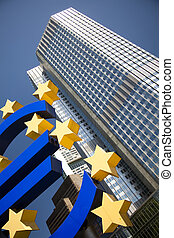 Euro sign and city - Euro symbol in european central bank in...