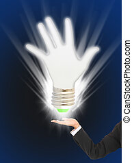 Eco green light bulb in business hand - Eco green light bulb...