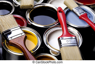 Colorful cans & paints - Cans and paint and brushes on the...