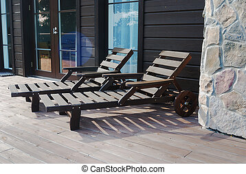 two wooden deck chairs on the terrace