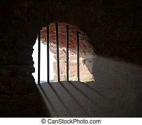barred window at Wertheim Castle - indoor shot of a...