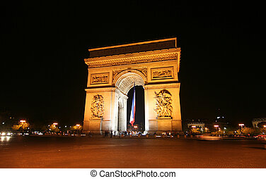 Arc de Triomphe at Night - Arc de Triomphe with French flag...