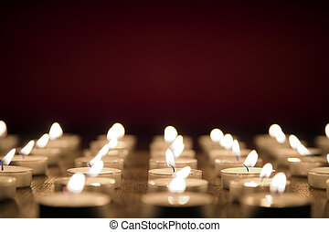Candles on red background, all saints day concept - Many...