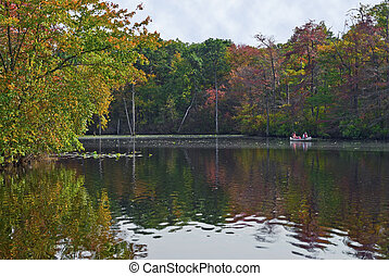 Quiet Fishing - Fishermen in a canoe off in the distance in...