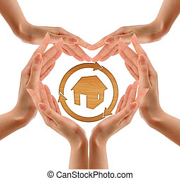 Hands make shape with wood house