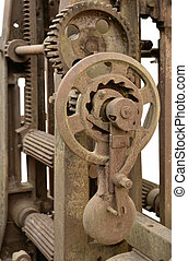 rusty machine detail - detail of a rusty historic...