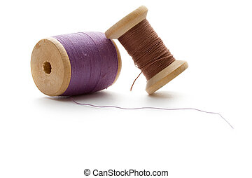 Thread bobbins on the white background
