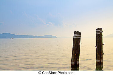 Lake - View of a lake with two wooden poles