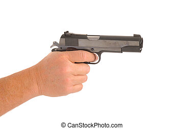 hand holding semi-automatic pistol cocked ready to fire,...