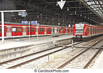iron classic train station from inside with red trains