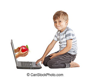 hand with an apple and through the computer screen