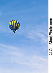 Hot Air Balloon in cloudy sky - Hot Air Balloon with blue...