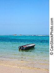 Boat in caribbean beach. Tayrona National Park. Colombia