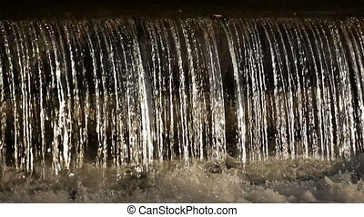 Waterfall of pure water on a black background
