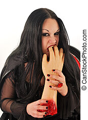 woman gnawing on hand - evil woman gnawing on hand