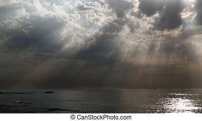 Celestial beams - Sunbeams through the clouds on the...