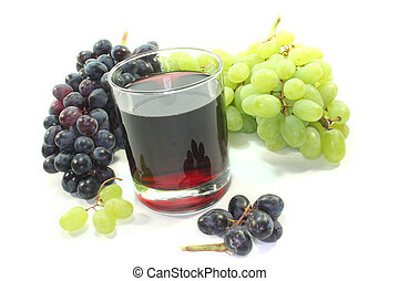 Grape juice with light and dark grapes on a white background