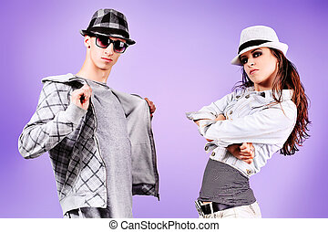 cool - A couple of young man and woman dancing hip-hop at...