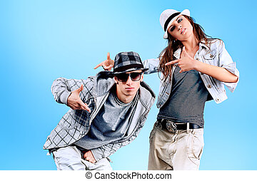 break - A couple of young man and woman dancing hip-hop at...
