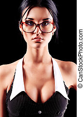 glasses - Sexy young woman posing over black background.