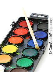 Used water color paint box with a brush close up